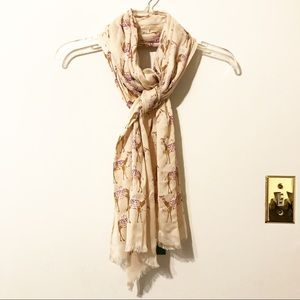 "Kate Spade ""Camel March Print Oblong Scarf""."